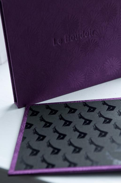 Boudoir album details in purple silk brocade.